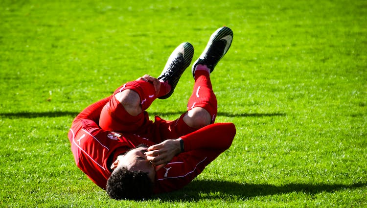 Football player on the ground injured